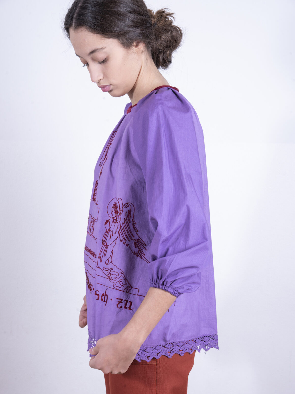 Purple blouse with clerical embroidery