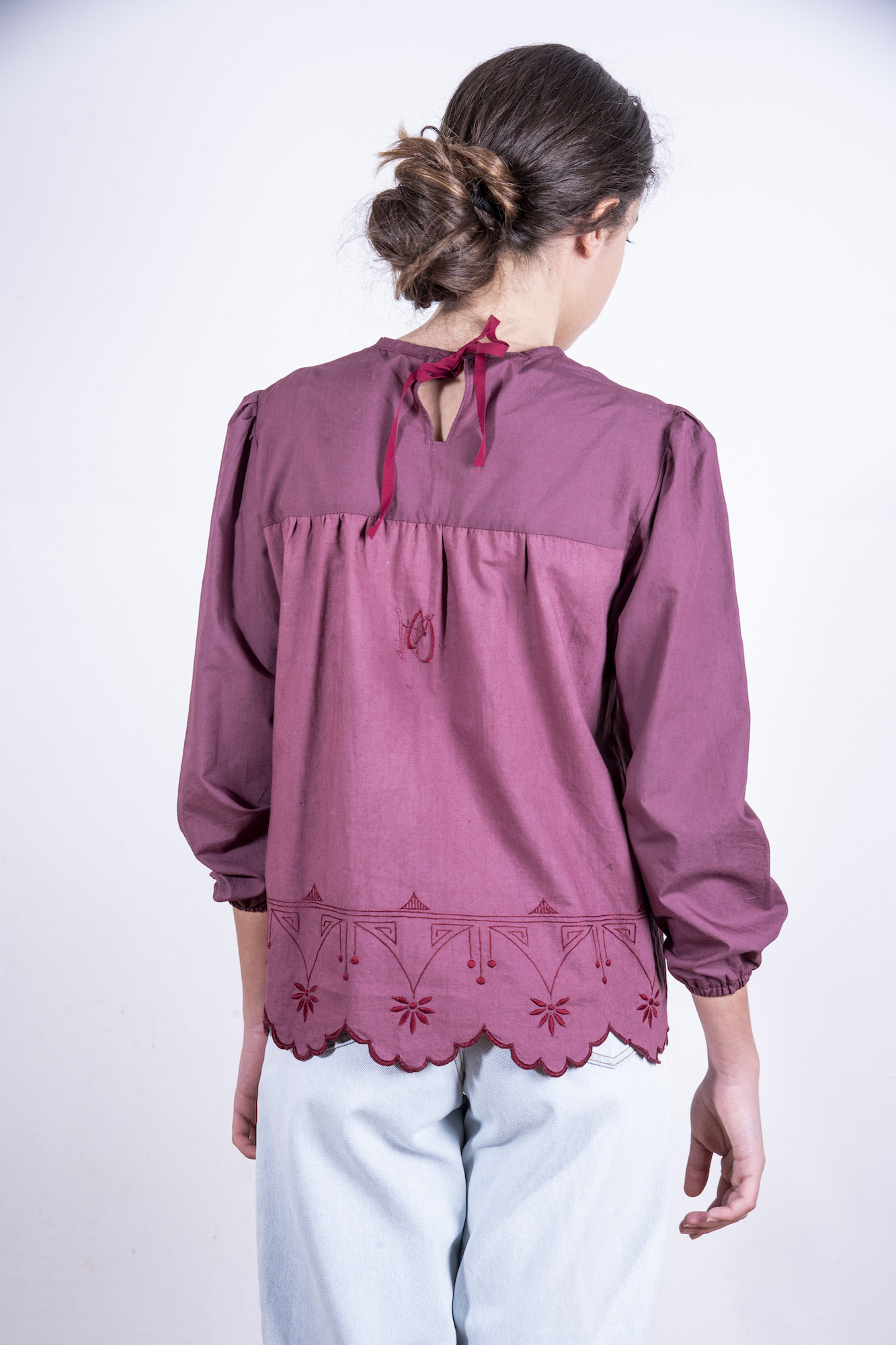 Ruby red blouse with embroidered scalloped edges