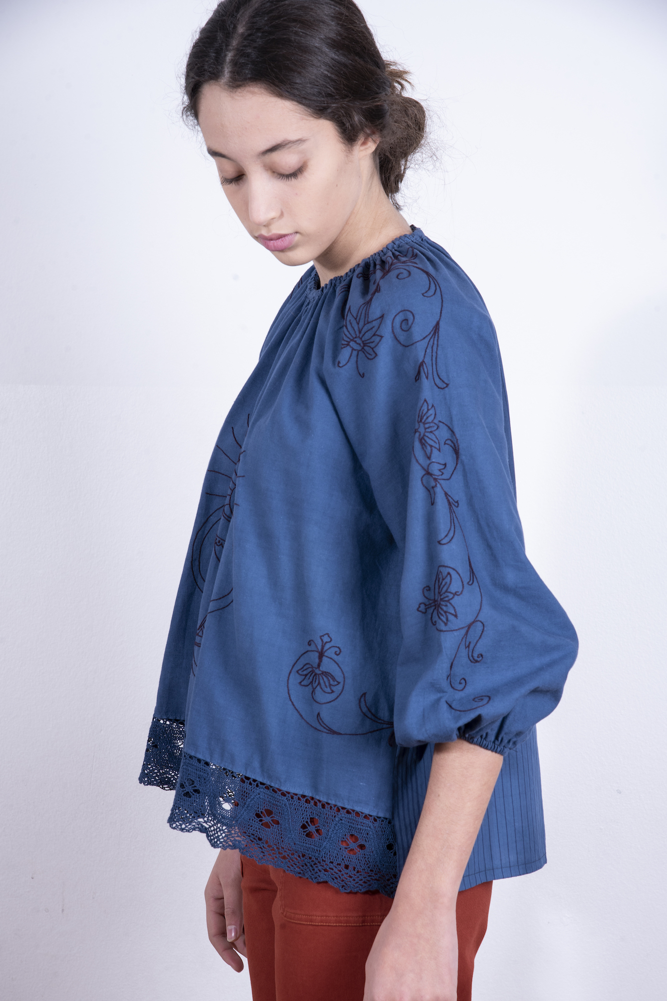 Blue blouse with ecclesiastical embroidery